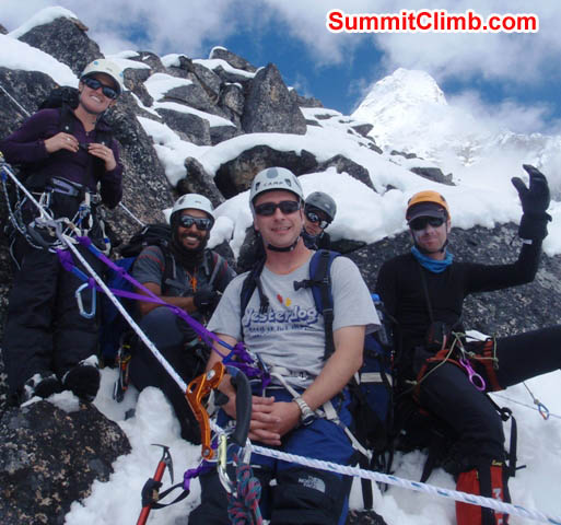 Maggie, Saz, Nathan, Tim, and Mark at the top of the practice rocks above basecamp.Summit of Ama Dablam in background. Photo by James Barritt
