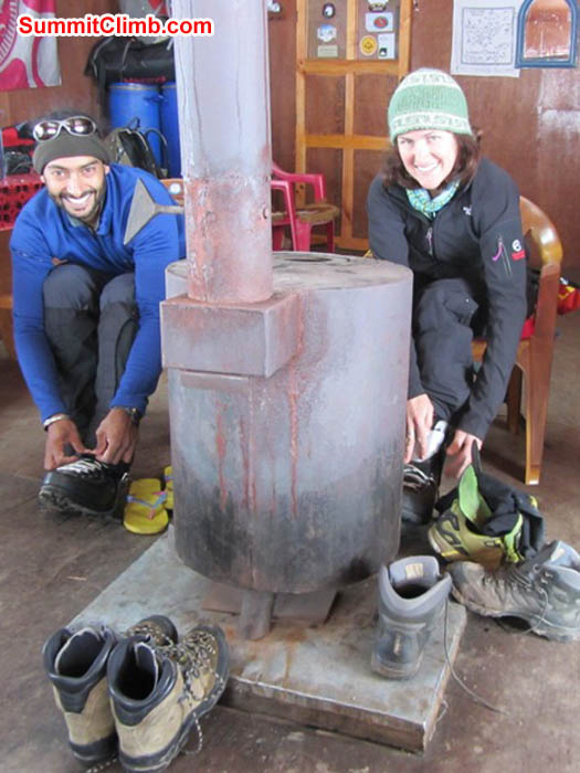 Saz and Maggie put on their climbing boots in the Mingbo Lodge. Photo by Mark van 't Hof