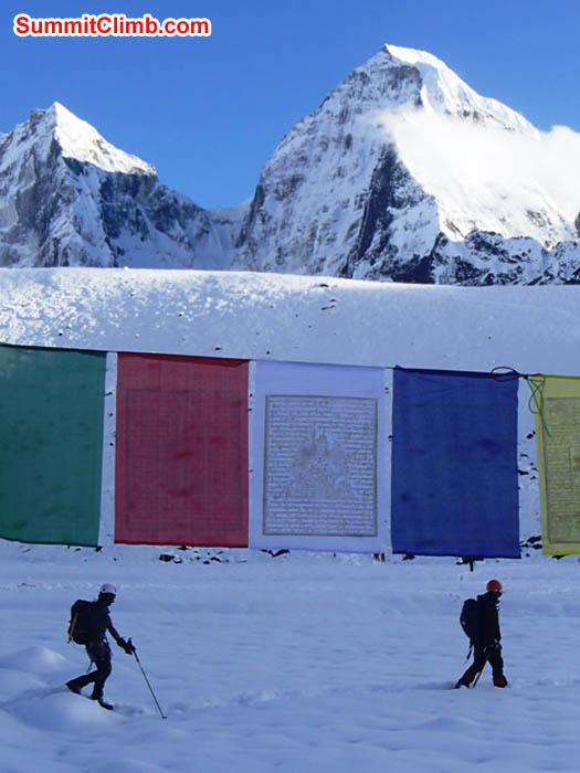 Prayer flags and walkers in Ama Dablam basecamp. Maggie Noodle photo
