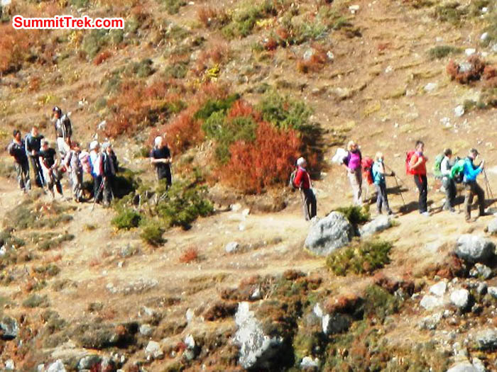 Trekkers enjoying a sunny stroll along the trail to Everest Basecamp. Photo by Sangeeta Sindhi