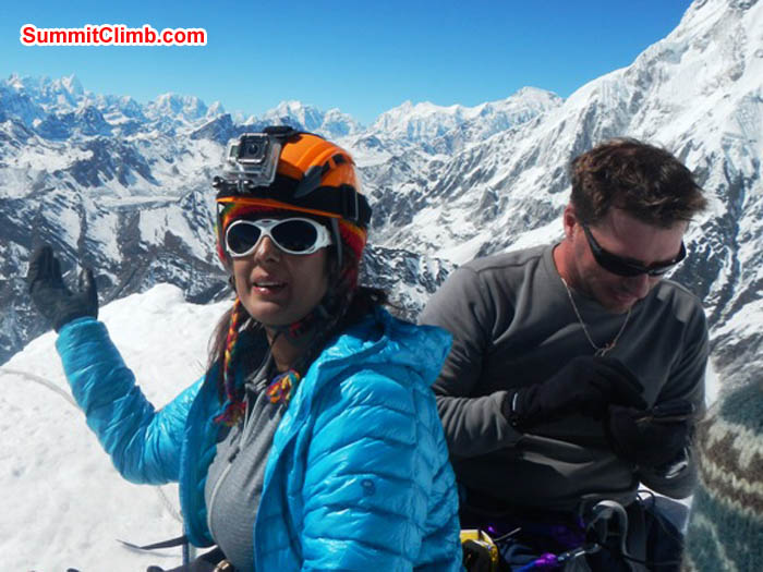 Sangeeta shows us the view from the Island Peak summit while Nathan sends an sms - text message to his loved ones at home. Photo Thile Nuru Sherpa.