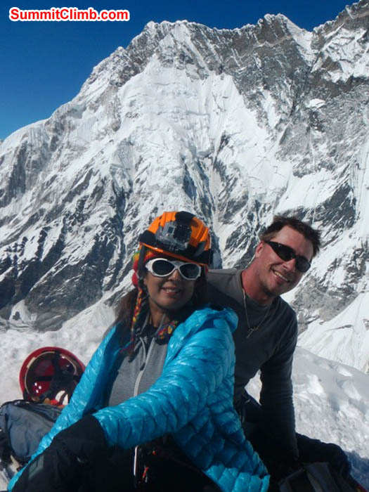Sangeeta and Nathan enjoying a beautiful summit day on Island Peak with Mount Nuptse in the background. Photo by Thile Nuru Sherpa