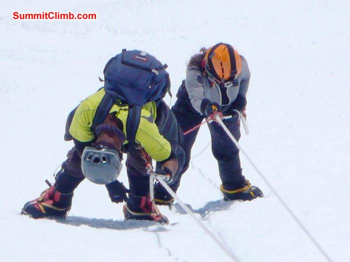 Thile Nuru Sherpa and Sangeeta Sindhi climbing the final pitch on the Island Peak headwall. Photo by Dan Mazur