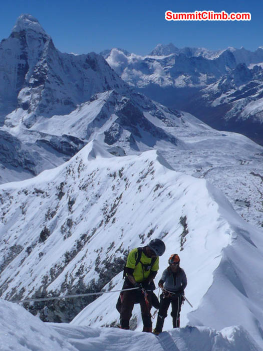 Thile Nuru Sherpa and Sangeeta Sindhi climbing the final ridge to Island Peak. Photo Dan Mazur