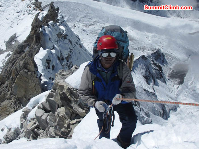 Jangbu Sherpa climbing a snowy ridge on the way to camp 2. Photo Sarabjit Bhooee.