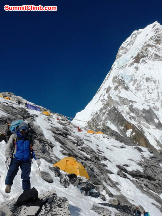 Jangbu Sherpa carrying a load in camp 1. Mark van 't Hof Photo.
