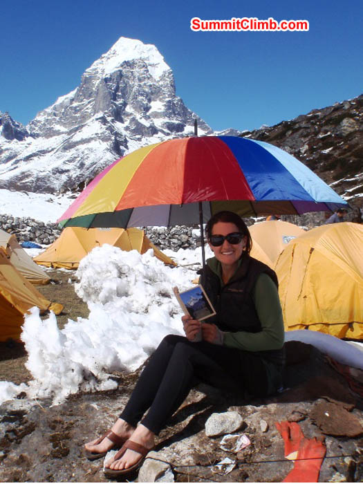 Maggie suns and reads in basecamp. James Barritt Photo.