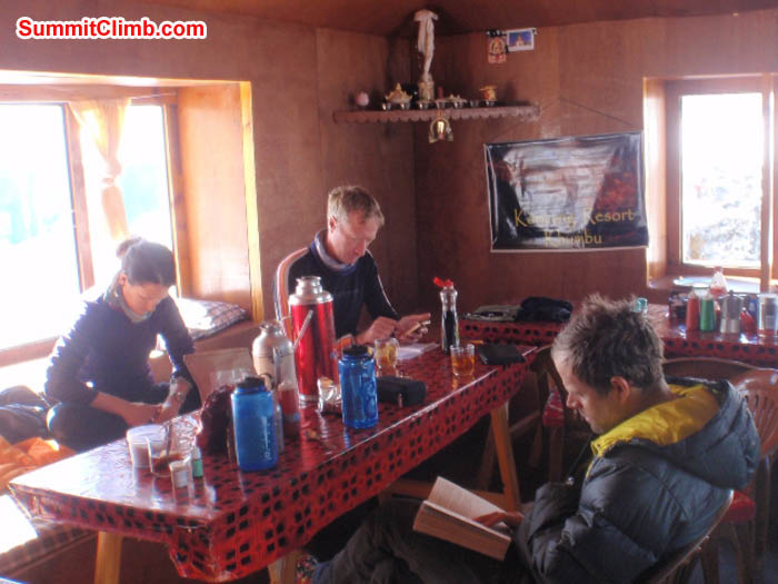 Maggie, Mark, and Tim reading in the Mingbo Lodge Dining Room, also known as 'our home'. James Barritt Photo.
