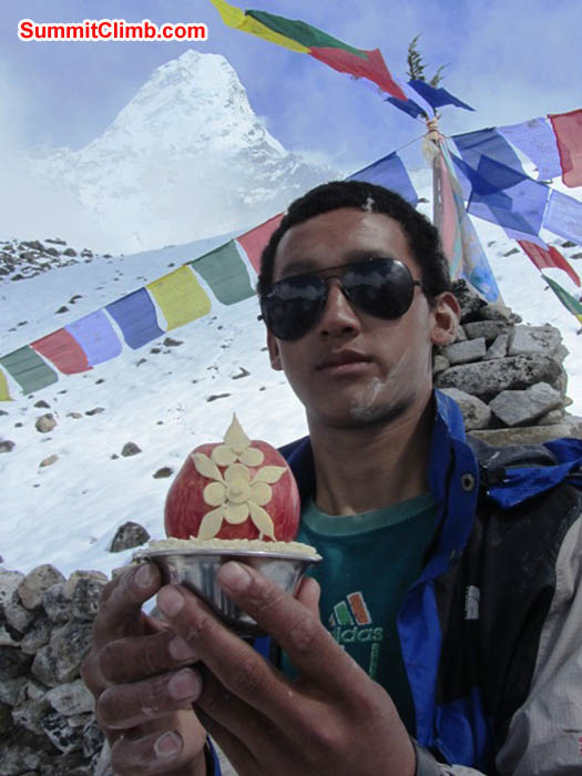 Phurba Sherpa holds a sacred butter and apple offering at the basecamp prayer ceremony. Mark van 't Hof Photo.