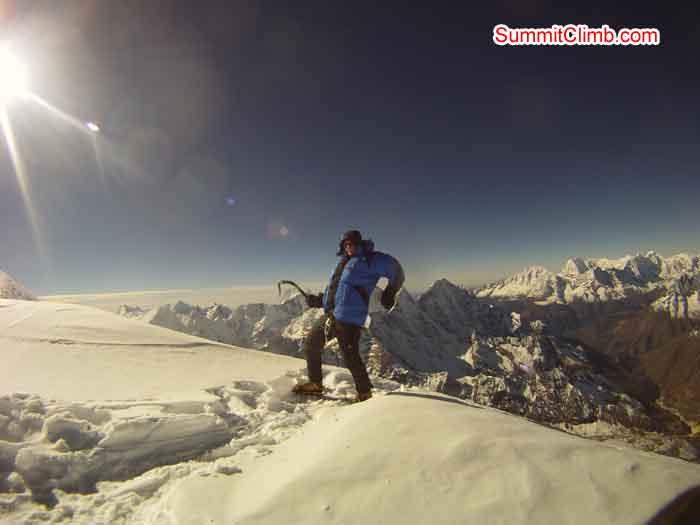 Fernando Joerger enjoying the summit of Amadablam. Photo by Andreas Schelling.
