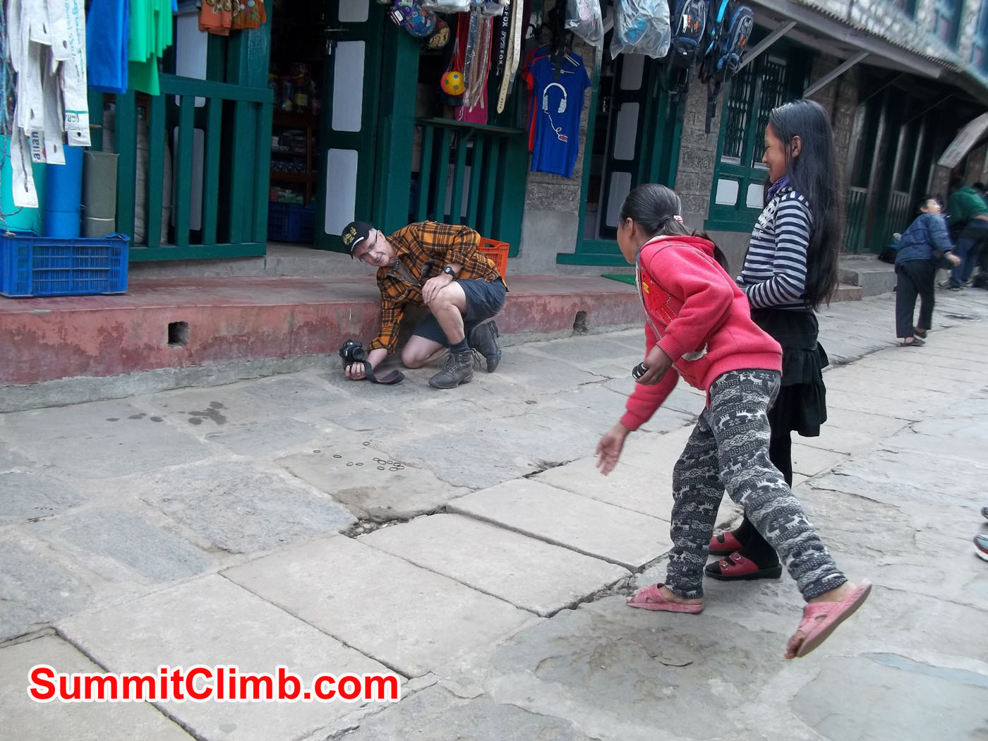 Graham playing with Kids in Lukla