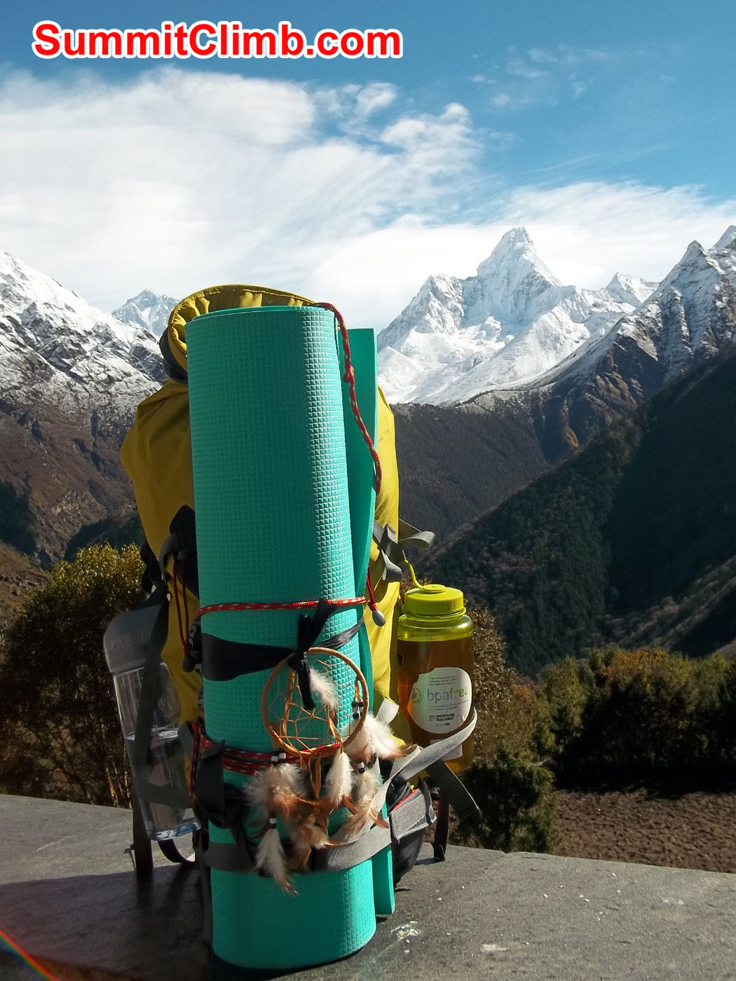 Climbing pack with the view of AmaDablam