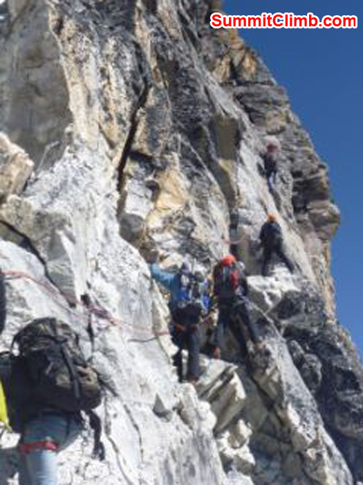 team climbs the yellow tower at 5900m, the crux of the climb, amadablam
