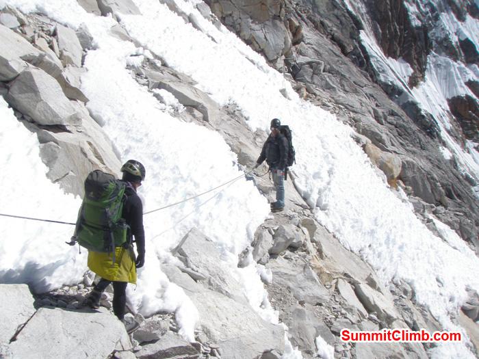 Start of fix line after camp 1. Ang Dorjee Sherpa helping member. Photo Kunnar Karu