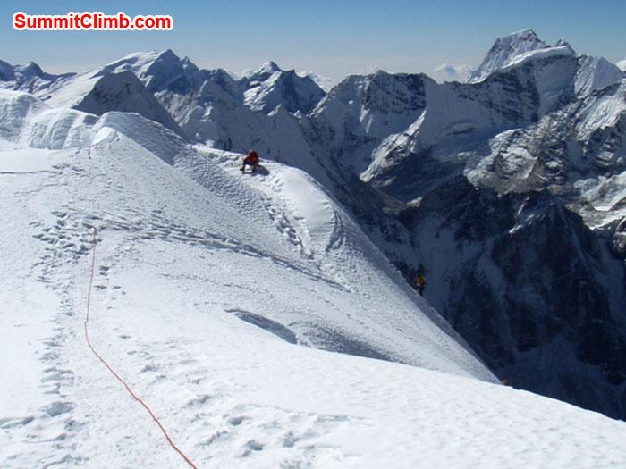 Photo of Korean Team reaching the summit. Kangtega Himal in the background. Photo by Maaike Braat