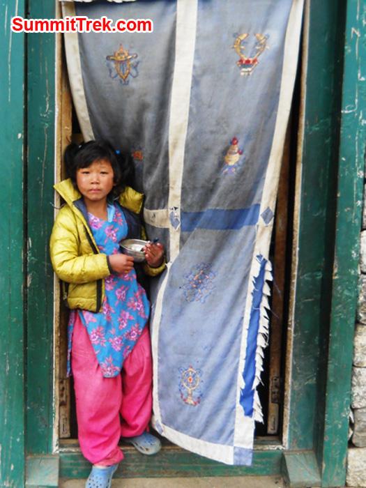 Girl standing in a doorway in lukla
