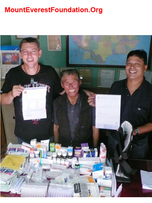 Paul Brophy presenting medicines to Jangbu Sherpa and Murari Sharma of the Mount Everest Foundation. Many Thanks to Mater Misericordiae Hospital Rockhampton and the Archdiocese
