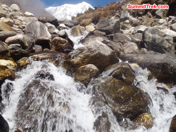 Waterfall near the village of Kote. One of the summits of Mera Peak is visible at the top of the photo. By Andrew Davis