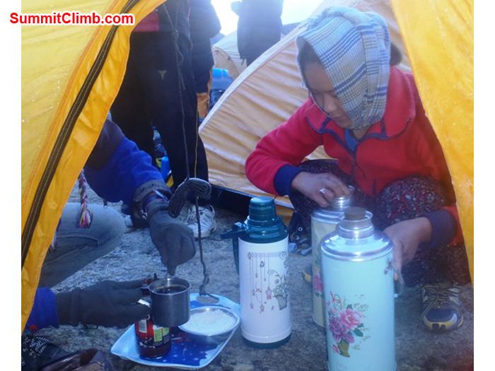 Ms. Yangjie Sherpa serves good morning wakeup tea. Photo by Andrew Davis