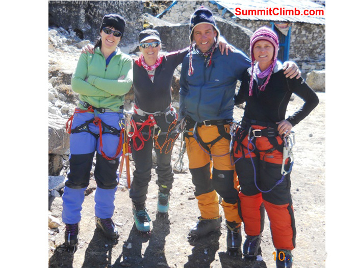 Australian friends Jules, Alice, Perry, and Sonja trying out their climbing harnesses. Photo by Jennifer Klich