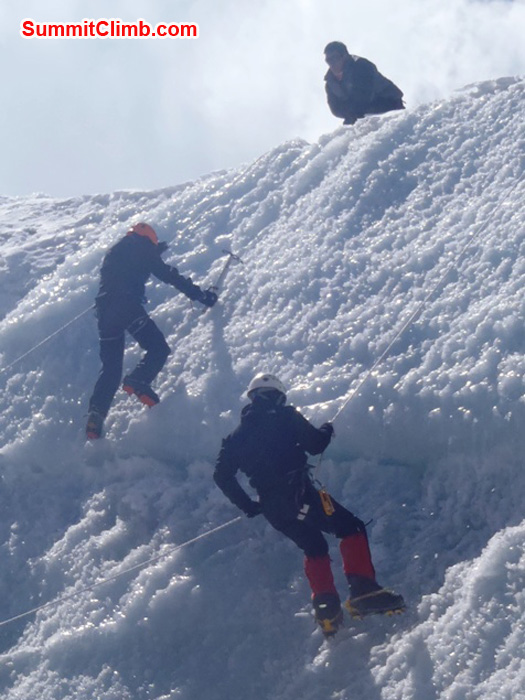 Ice practice on Naulekh Glacier - Ang Pasang Sherpa looks on while Frank Seidel ascends and Andrew Davis descends. photo by Richard Cotter from Berghaus