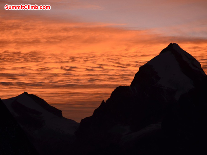 Golden sunset over Triputi Peaks, as seen from Kare Village. Photo by Michael Moritz.
