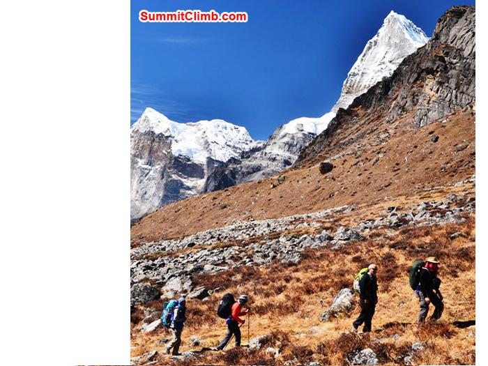 Team walks to Kare Village, Triputi Peaks in the background. Photo by Michael Moritz.