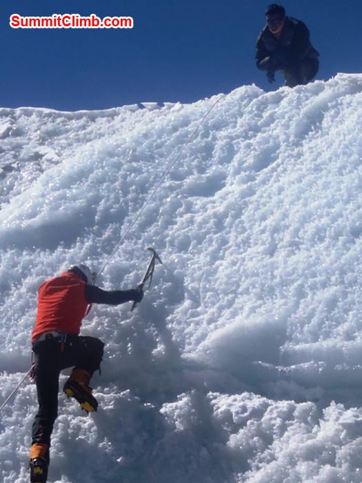 Richard Cotter (BERGHAUS) flashing an ice-wall at Naulekh Glacier. Photo by Andrew Davis.