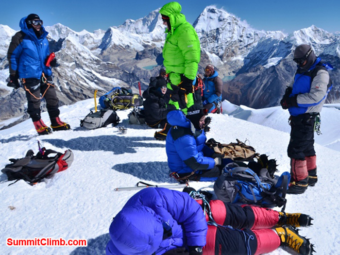 Mera Peak Team resting on the foresummit, before ascending final ropes to the top. It is a perfect sunny day with no wind. Photo by Michael Moritz.