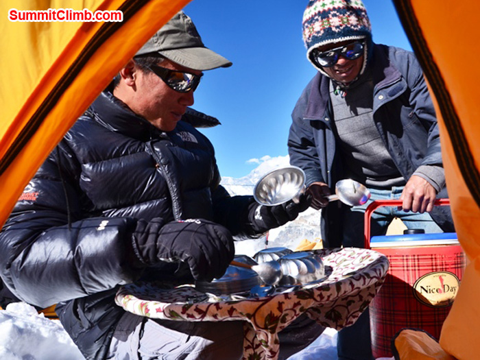 Staff serving delicious lunch to members in tent on Mera Peak. photo by Michael Moritz