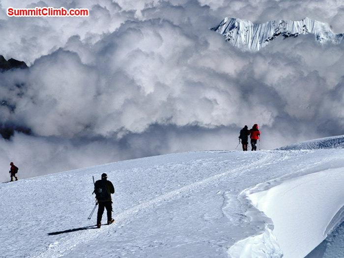 Climbers descending the zig zag trails past crevasses and clouds, coming down Mera Peak. Photo by Micheal Moritz.