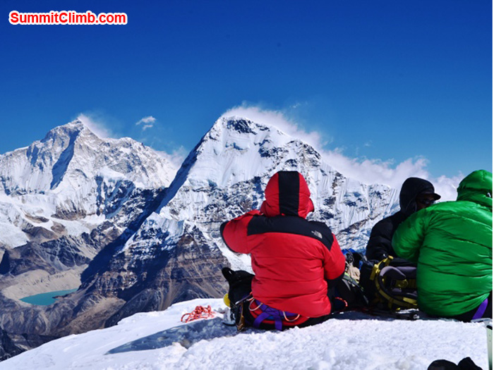 Lounging atop Mera Peak, soaking up the views of Lhotse South Face and Everest. Photo by Michael Moritz.