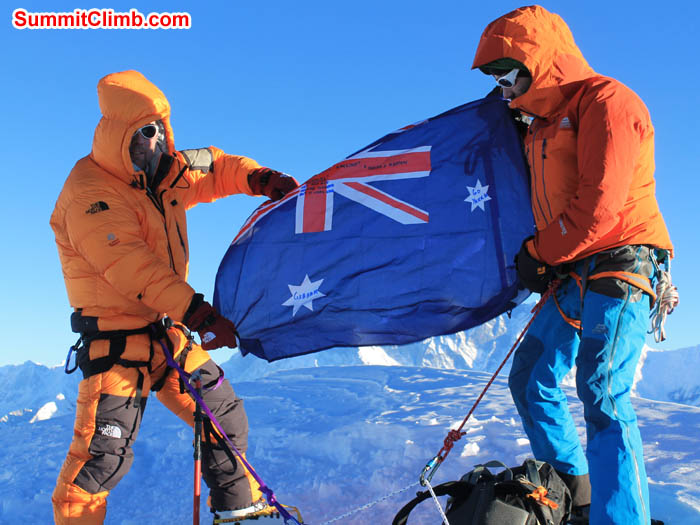 Summit Day of Mera Peak. Ray showing the his country flag with the help of Felix, Team leader. Photo Ray