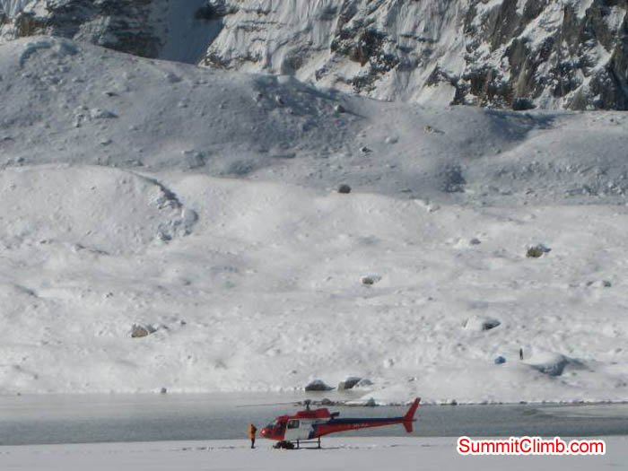 Helicopter rescue at Baruntse lake near basecamp. Jussi Kuva Photo.