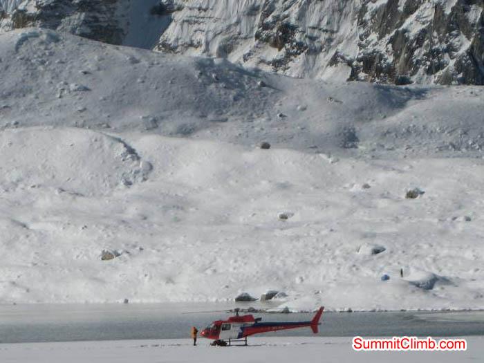 Helicopter rescue at Baruntse lake near basecamp. Jussi Kuva Photo.