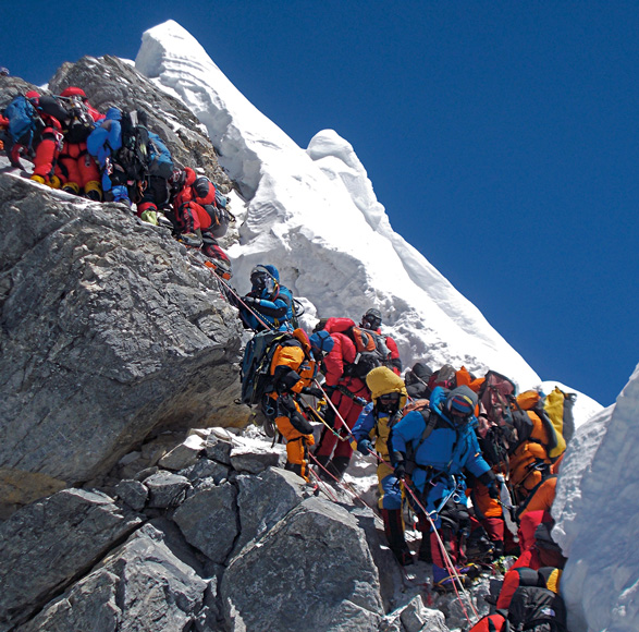 Traffic chokes the Hillary Step on May 19, 2012. Some climbers spent as long as two hours at this 40-foot rock wall below the summit, losing body heat. Even so, 234 people reached the top on this day. Photograph by Subin Thakuri