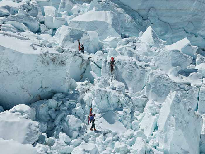 Climbers descend through the Khumbu Icefall after spending time higher up on the mountain to acclimatize. This part of the icefall is known as the Popcorn Section, because that's what its jumbled (and jumbo) blocks of ice resemble. Photograph by Andy Bardon