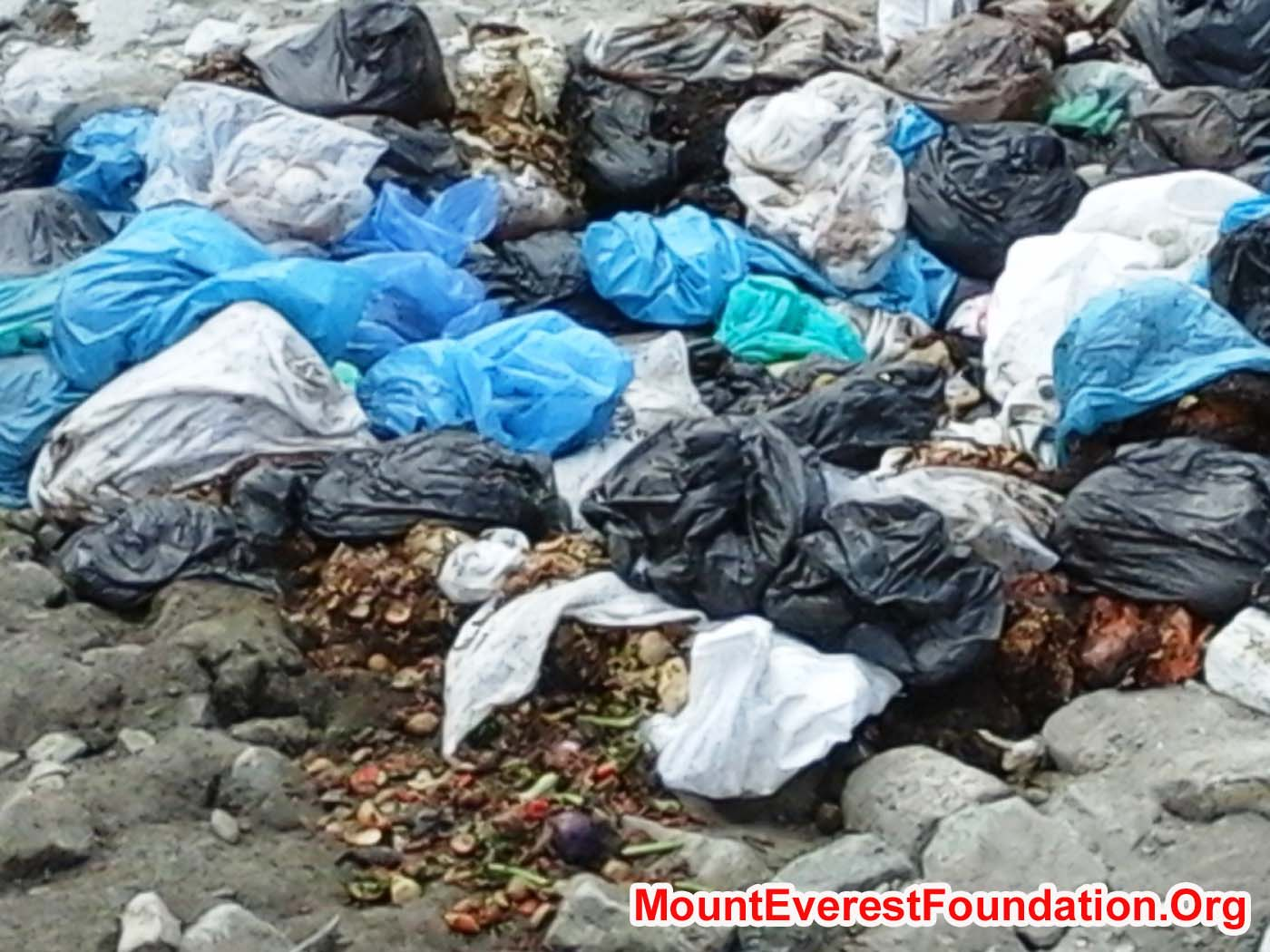 Closeup photo of waste pit contents at Kyakpa Yul