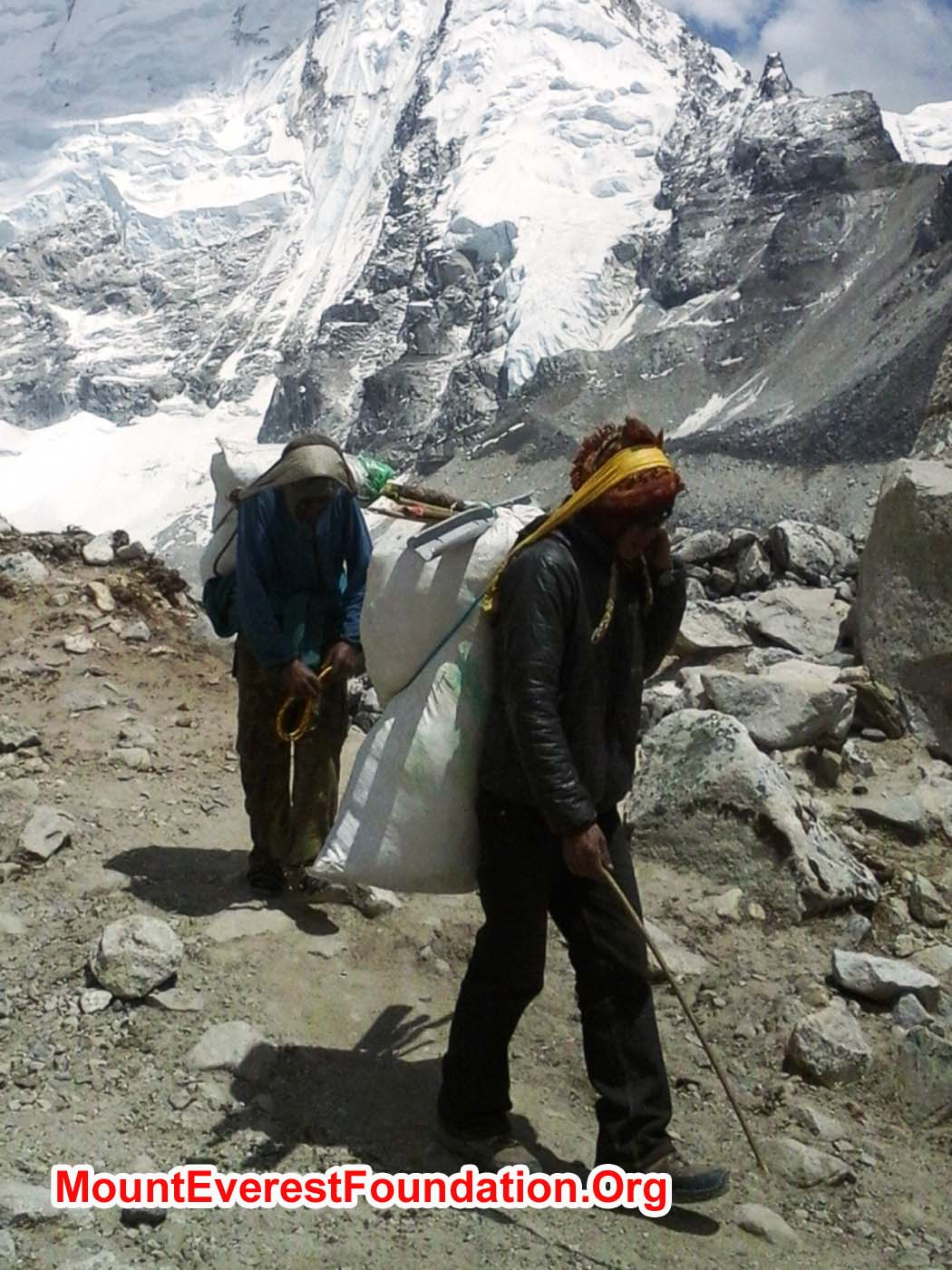 Porters carrying out tins, bottles, paper, and plastic from Mount Everest basecamp
