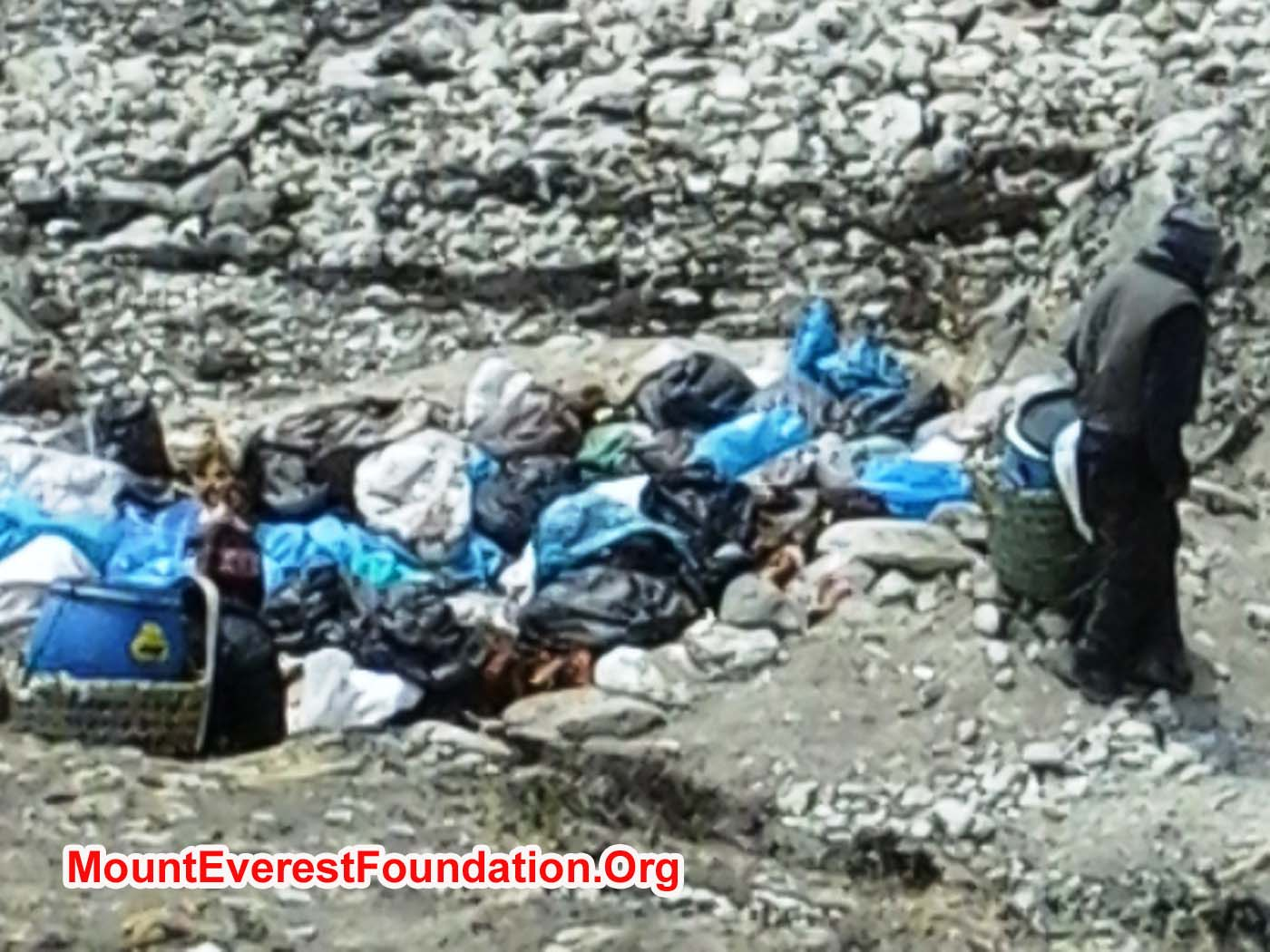 Porters preparing to empty their human waste drums from Everest basecamp into the pits at Kyakpa Yul