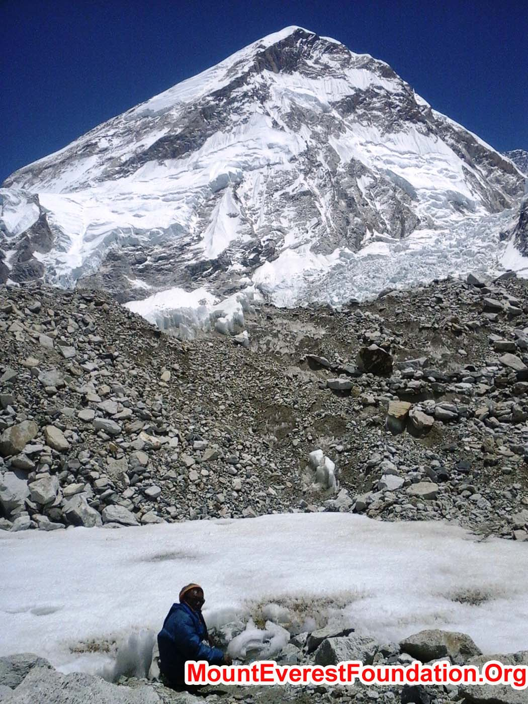 Rukman Sunwar collecting a water sample from Mount Everest base camp