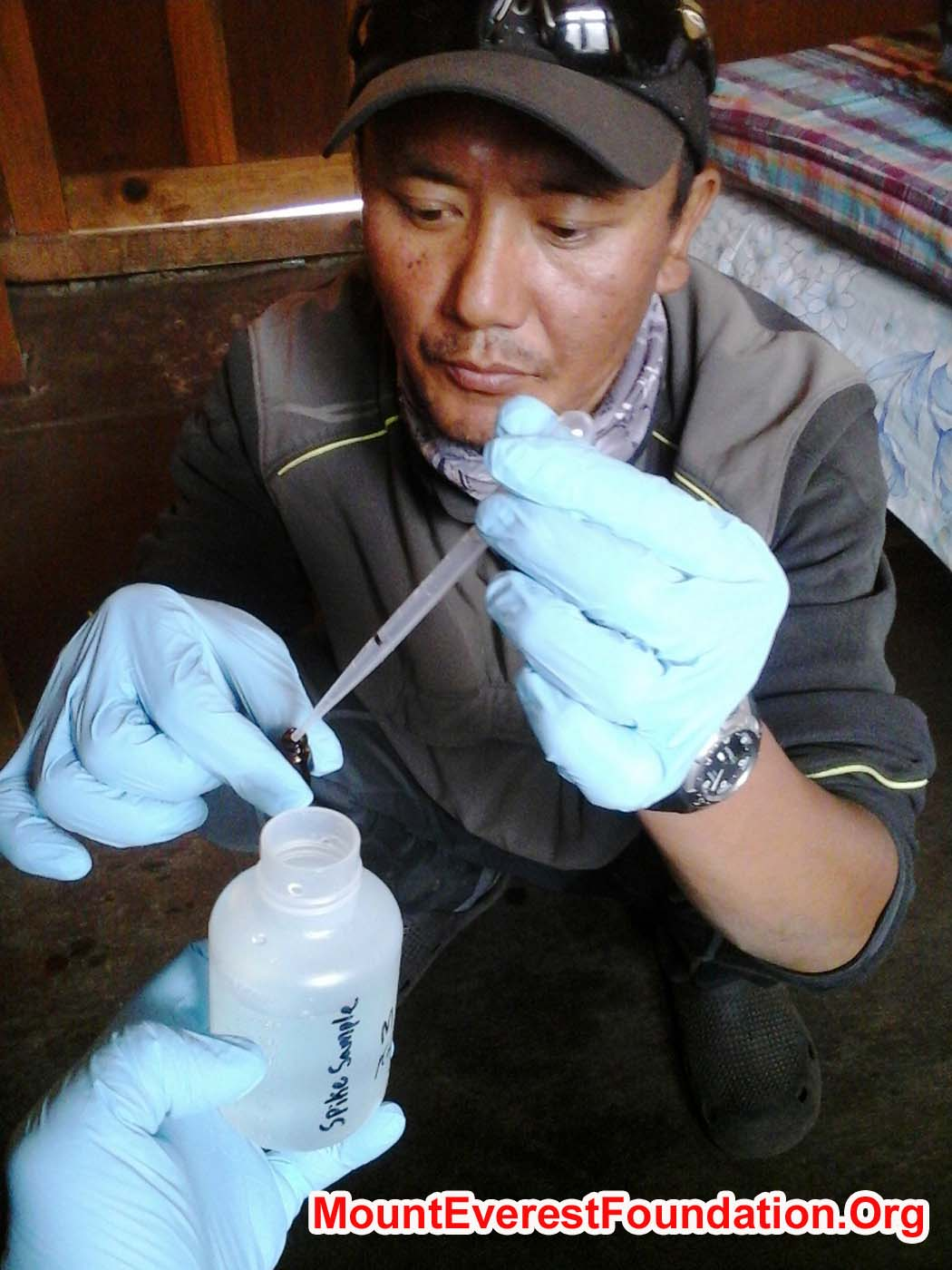 Thile Nuru Sherpa spikes a water sample