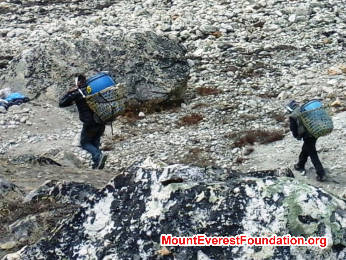 > Porters carrying human waste drums from Mount Everest base camp to be dumped into the pits at Kyakpa Yul