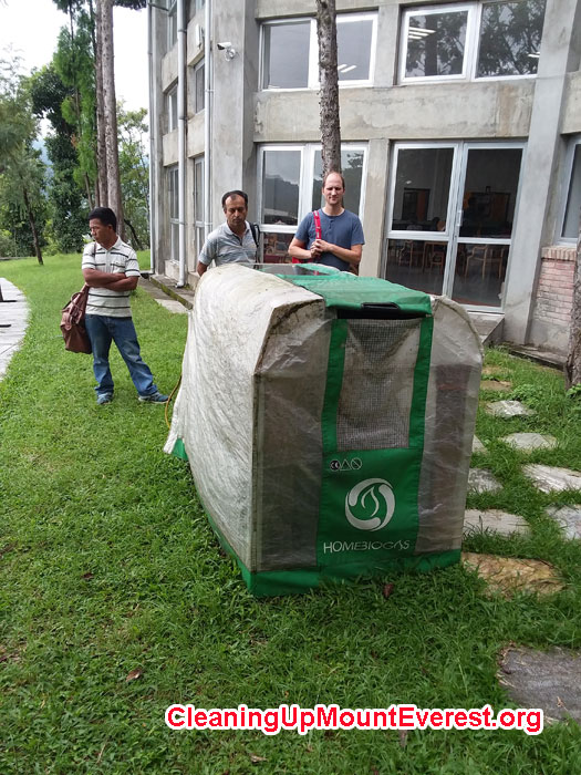 Professor-Bed-Mani-KU,-and-Mike-Marsolek-SU-in-front-of-portable-biogas-digester.jpg