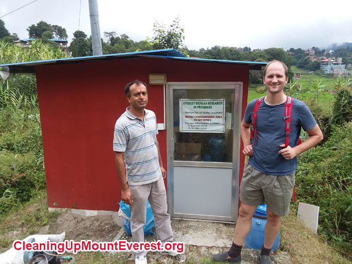 Professor Bed Mani (KU), and Mike Marsolek (SU) in front of the new Everest Base Camp Waste Treatment Research Building at Kathmandu University