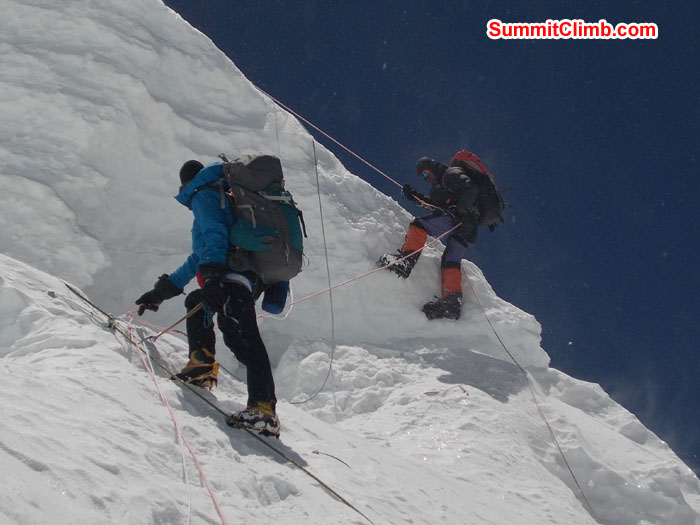 Overhang just below camp 2. Members using fixed ropes while coming down. Photo Wayne Herrick
