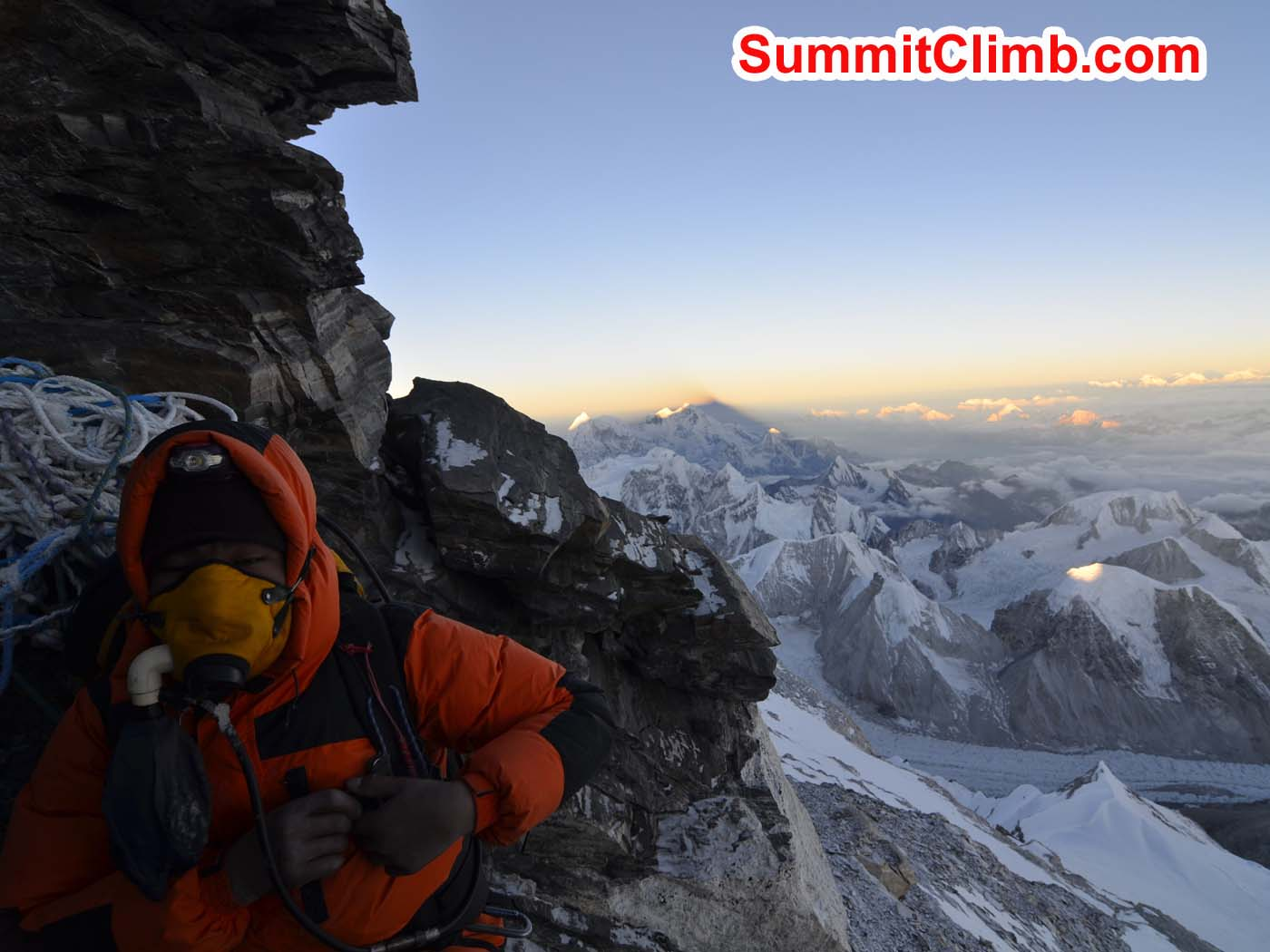 Pasang Sherpa takes a break in the rock band during the ascent to the summit. Dmitri Nichiporov photo