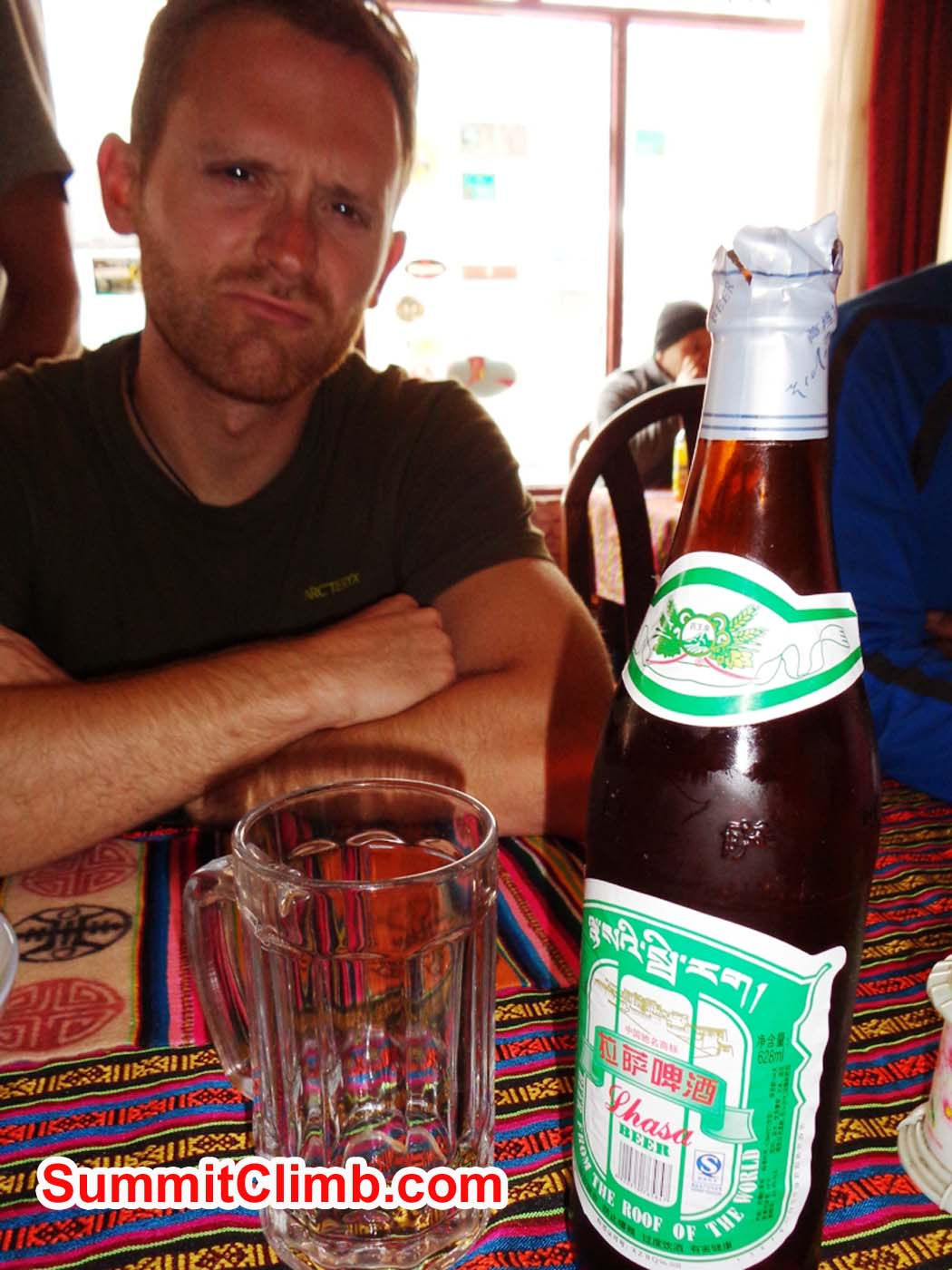 Jan 'enjoys' the first Lhasa beer after entering Tibet. Sacha Guittet photo