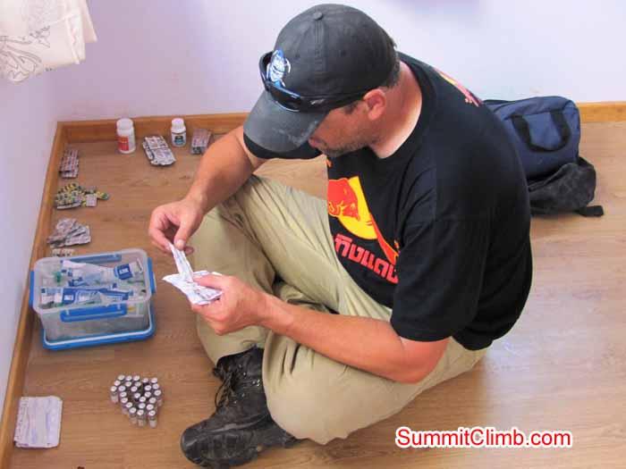 steve packs medical kits in Kathmandu1. Troy Bacon Photo