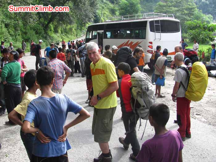 Andre supervising the loading of the bus on the Arniko Highway. Troy Bacon photo
